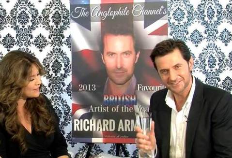 "RA accepts his ""British Artist of the Year Award"" from The Anglophile Channel's Marlise Boland."