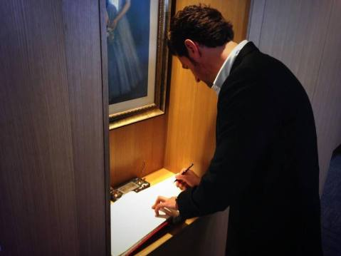 RA signs the legendary Guest Book at the LA British Consulate.