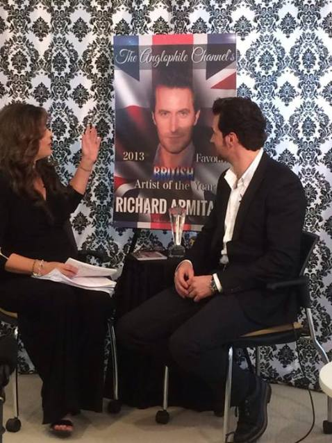 Another photo from The Anglophile Channel shoot:  RA admires our FB pal Thorin of Erebor's work on the poster done for the interview!