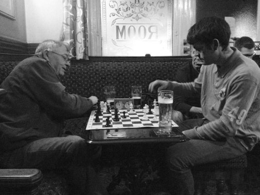 Author Bernie Hare and Lee Kirton (Urban) enjoy a match of speed chess.